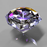 Diamond in the colored light. On gray beckground Royalty Free Stock Photos
