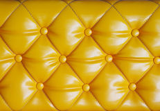 Diamond cushion pattern of yellow vintage sofa, texture and back Stock Photography