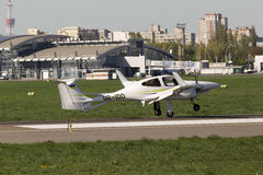 Diamond DA42 Twin Star business aircraft landing on the runway Stock Photos