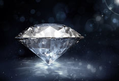 Diamond on dark background. Big diamond on dark background Royalty Free Stock Photo