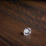 Diamond on dark parquet Stock Images