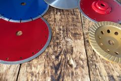 Diamond discs for concrete, reinforced concrete, granite and stone on the background of a wooden old board royalty free stock photo