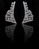 Diamond earings with reflection Royalty Free Stock Image