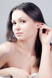 Diamond earring & Sexy beautiful young woman Royalty Free Stock Photos