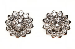 Diamond earrings. Picture of a pair of diamond earrings Stock Images