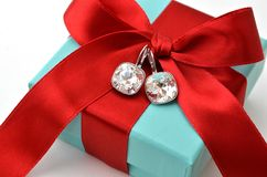 Diamond Earrings. On blue box royalty free stock images