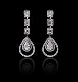 Diamond Earrings on a black reflective background Stock Photos