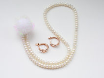 Diamond earrings and pearl necklace Royalty Free Stock Images