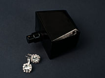Diamond earrings and perfume Royalty Free Stock Image