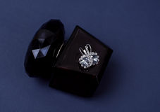 Diamond earrings and perfume Stock Images