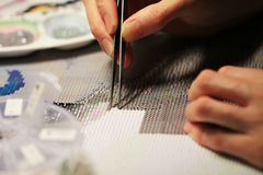 Diamond embroidery - new trendy type of hobby Stock Image