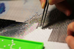 Diamond embroidery - new trendy type of hobby Royalty Free Stock Image