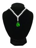 Diamond and emerald necklace on black mannequin Royalty Free Stock Image