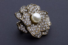 Diamond encrusted brooch with pearl center-piece Royalty Free Stock Image