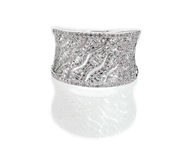 Diamond encrusted engagment wedding anniversary ring. Isolated on a white background with a reflection Royalty Free Stock Photo