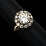 Diamond  engagement ring. Massive  diamond  gold ring on white Royalty Free Stock Images