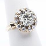 Diamond  engagement ring. Massive  diamond  gold ring on white Stock Image