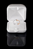 Diamond engagement ring. Boxed engagement ring with a brilliant cut diamond set in yellow and white gold Stock Images