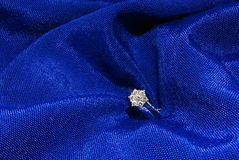 Diamond engagement ring 3. Diamond engagement ring in blue cloth Royalty Free Stock Photo