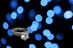 Diamond engagement ring on abstract blue background Royalty Free Stock Photography
