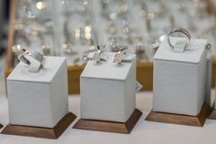 Diamond engagement rings in a jeweler shop display. selected focus royalty free stock photo