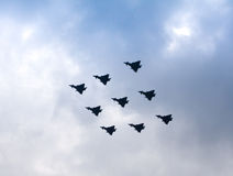 Diamond Flypast by RAF Typhoons. Flypast of a formation of 9 RAF Typhoons in a diamond shape to celebrate the Queen Elizabeth II diamond Jubilee. Taken overhead royalty free stock photos