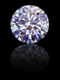 Diamond on glossy black background Stock Image