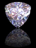 Diamond on glossy black background Stock Photos