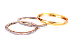 Diamond and gold bangles Royalty Free Stock Image