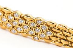 Diamond and gold bracelet Royalty Free Stock Image