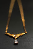 Diamond and gold chain Stock Photos