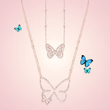 Diamond gold jewelry necklaces with butterfly. On pink background Royalty Free Stock Photos