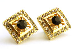 Diamond and gold stud earrings Royalty Free Stock Image
