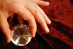 Diamond in hand. Diamond with facets that sparkle brightly in the light Royalty Free Stock Images