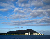 Diamond Head Crater. This image was taken from a boat in Oahu, Hawaii. The city in the distance is Waikiki royalty free stock image