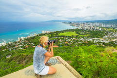 Diamond Head Travel photographer. Travel photographer takes a shot of Honolulu and Waikiki beach, Oahu in Hawaii from Diamond Head State Monument. Nature Stock Image