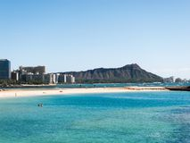 Diamond Head from Waikiki. With blue water in the foreground Royalty Free Stock Photo