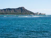 Diamond Head from Waikiki. With ocean and surf in the foreground Royalty Free Stock Photography
