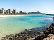 Diamond Head from Waikiki. With shallow water in the foreground Stock Image