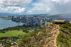 The Diamond Head war bunkers and the iconic Waikiki Beach in the. Background from the Diamond Head Volcano Walk on a sunny day at Waikiki Honolulu Hawaii on the royalty free stock photos