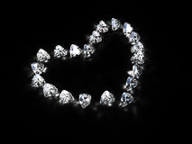 Diamond heart. Heart made of diamonds with refractions, isolated on black. 3d render Stock Photos