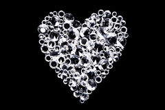 Diamond heart on black background royalty free stock image