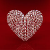 Diamond heart on red background. 3d render. Beautiful sparkling diamond on a light reflective surface. High quality 3d render with HDRI lighting and ray Stock Photos