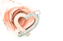 Diamond Heart shape pendant with pink rose. Stock Image