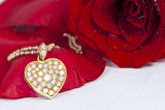 Diamond heart shape pendant and red rose Royalty Free Stock Image