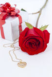 Diamond heart shape pendant and red rose. Valentine Series stock photo
