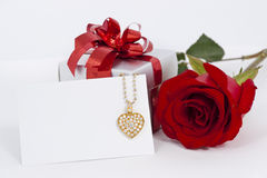 Diamond heart shape pendant and red rose. Valentine Series stock images