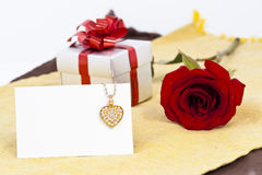 Diamond heart shape pendant and red rose Stock Photos