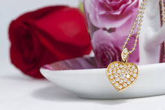 Diamond heart shape pendant and red rose. Valentine Series Royalty Free Stock Photography