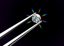 Diamond held by tweezers. Image include hand-draw  clipping path Royalty Free Stock Images
